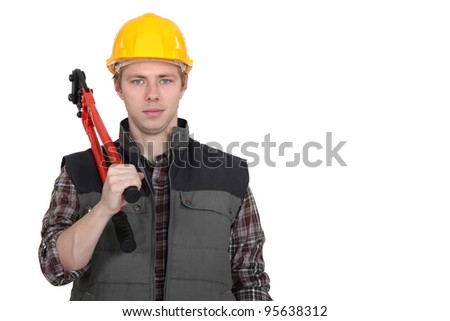 A construction worker with pliers. - stock photo