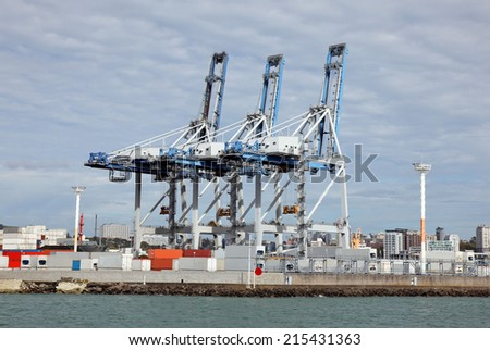A container terminal with loading crane in Auckland - New Zealand - stock photo