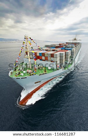 A container vessel arriving in port. - stock photo