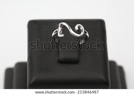 A contemporary ring on base,  isolated on white background - stock photo