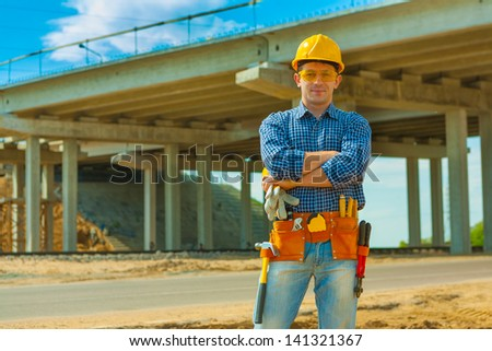 a contractor on building place - stock photo