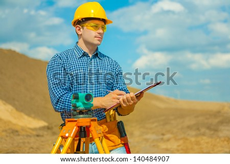 a contractor writing in clipboard - stock photo