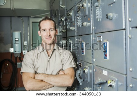 A Control Room Engineer. Power plant control panel. - stock photo