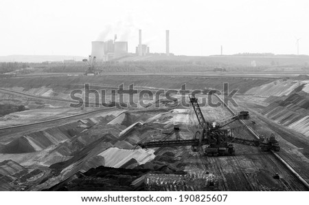 A conveyor belt and a very large backloader in a lignite (browncoal) mine - stock photo