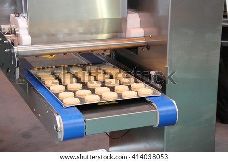 A Cookie Biscuit Making Food Processing Machine. - stock photo