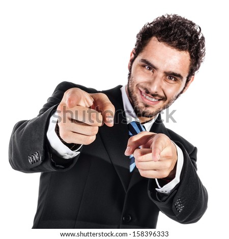 a cool and handsome businessman pointing at you with both index fingers (focus on fingers) - stock photo