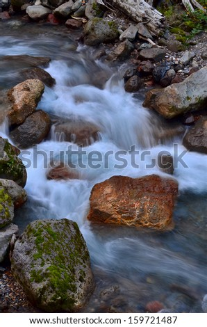 A cool and rocky mountain stream. - stock photo