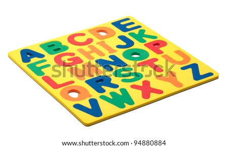 A copy of the alphabet made out of foam magnetic letters. - stock photo