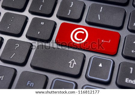 a copyright symbol on keyboard to illustrate the concepts. - stock photo