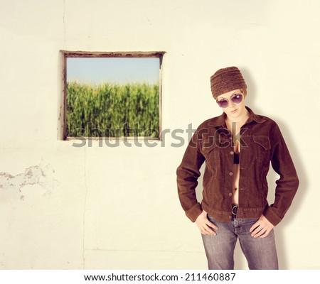 a corn field through an old broken out window - stock photo