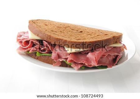 A corned beef and swiss cheese sandwich on rye - stock photo