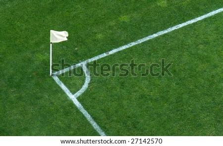 A corner flag on a soccer stadium green grass - stock photo