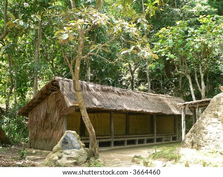 A cottage in the forest - stock photo