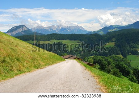 A country road on a hill in Austria, Europe - stock photo