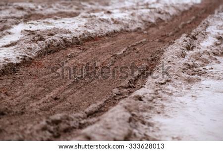 A countryside muddy road of Bangladesh - stock photo