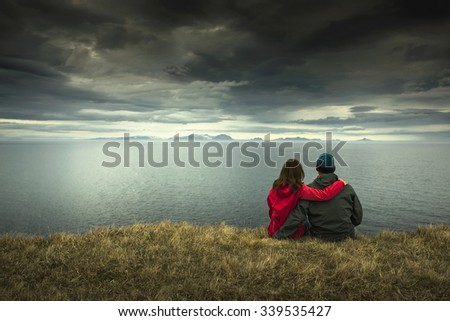 A couple contemplating the beautiful landscape - stock photo