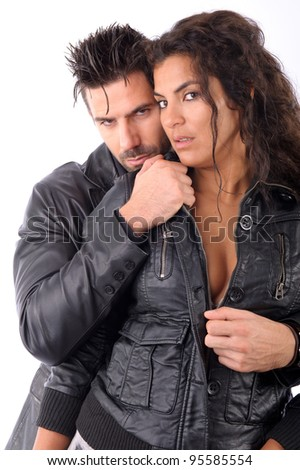 A couple embraced, both wearing leather jackets - stock photo