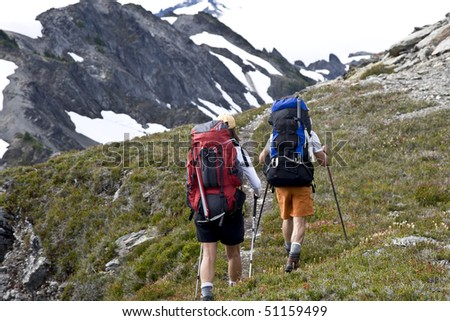 A couple hiking in the Mountains. - stock photo
