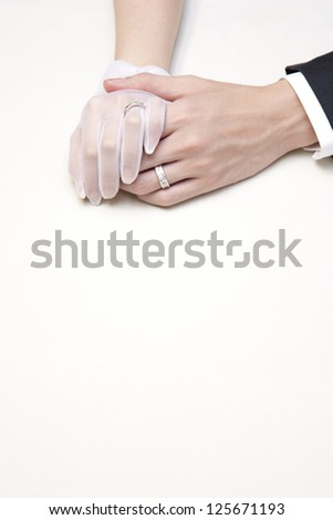 A couple holding hands - stock photo