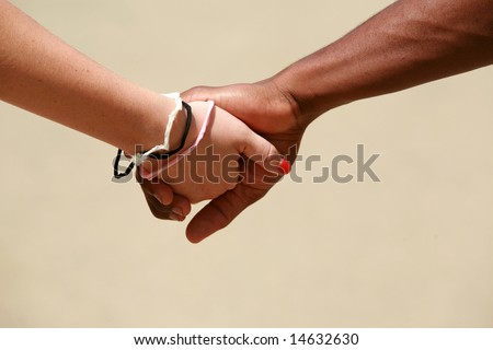 a couple holds hands - stock photo
