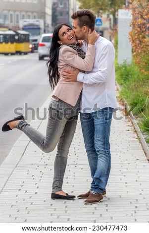 a couple is having fun in a city walk - stock photo