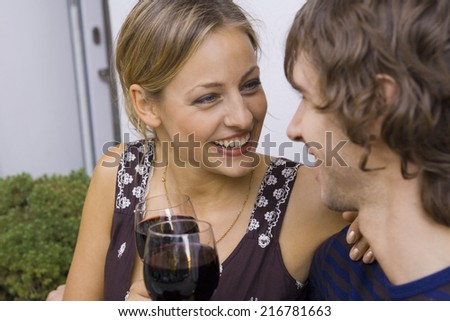 A couple making a toast with wine. - stock photo