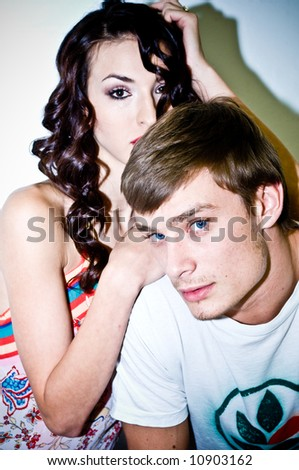 A couple, models shot in the studio. - stock photo