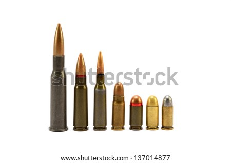 a couple of bullets on a white background in the vertical position - stock photo