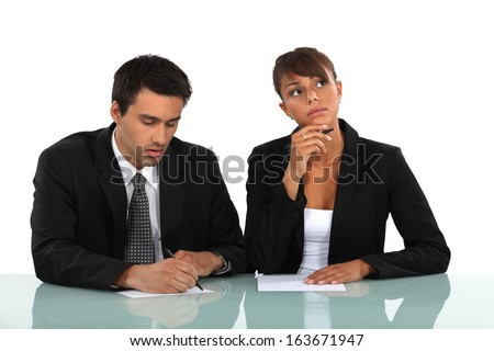 A couple of businesspeople working. - stock photo