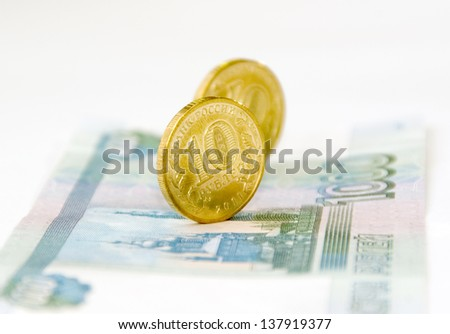 A couple of coins on a banknote - stock photo