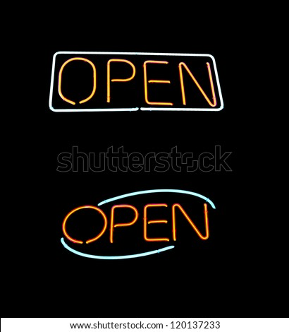 A couple of distinctive open neon signs - stock photo
