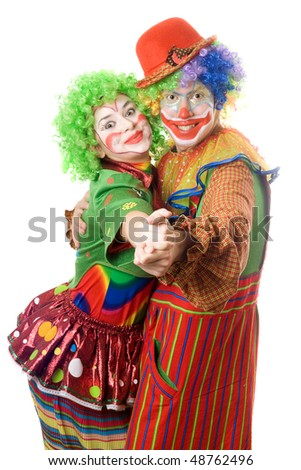 A couple of happy clowns dancing. Isolated - stock photo