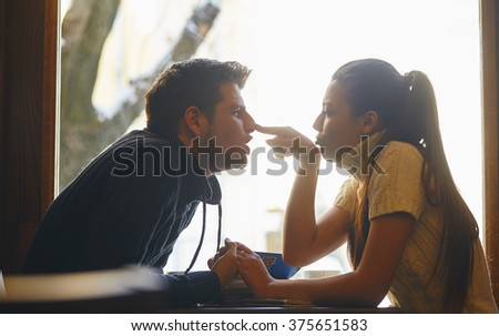 A couple on a date, posing in the cafe. - stock photo