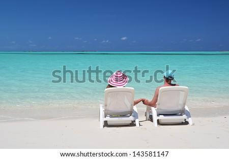 A couple on the beach of Exuma, Bahamas - stock photo