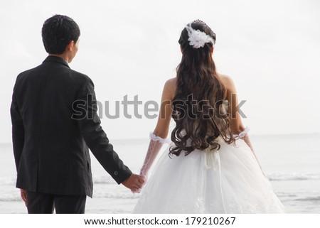 a couple wedding on the beach - stock photo