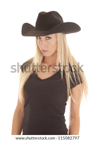 A cowgirl in her black western hat with a serious expression on her face. - stock photo
