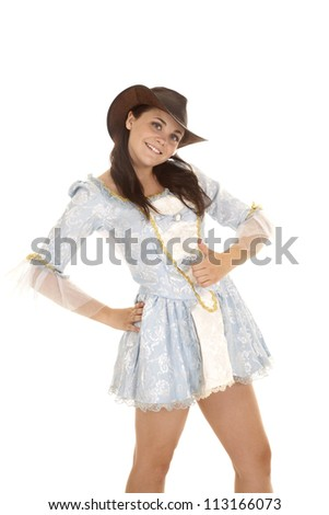 A cowgirl in her hat with her thumb up  and a smile on her face. - stock photo