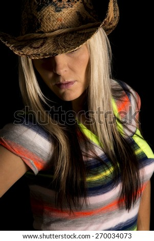 a cowgirl wearing her western hat, with her eyes hidden. - stock photo