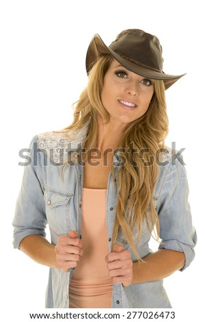 A cowgirl with her western hat on , she has a big smile. - stock photo