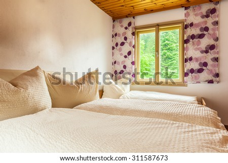 a cozy bed and breakfast or hotel bedroom in Austria - stock photo