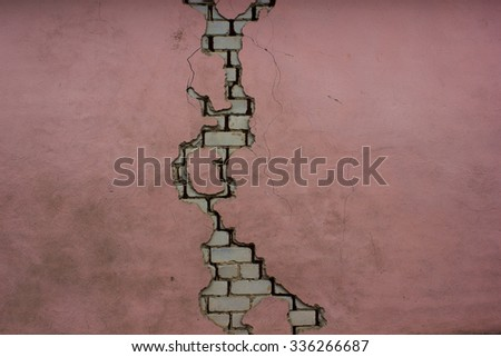 a crack in the wall - stock photo