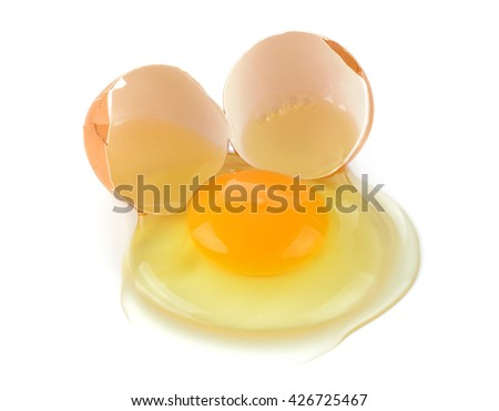 A cracked egg with an egg shell, egg yolk and egg white. - stock photo