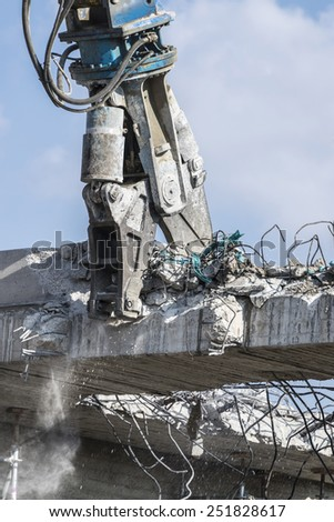 A crane breaking down a building - stock photo