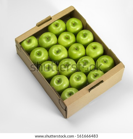 A crate of green apples on a white background - stock photo