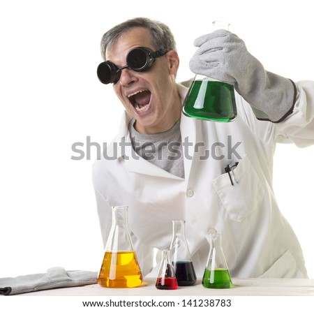 A crazy mad scientist in his laboratory experimenting on secret formulas. - stock photo