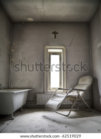 A creepy room, waiting for someone to step in and say their last prairs - stock photo