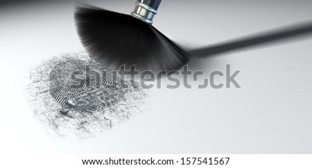 A crime scene brush dusting black talcum powder revealing and a fingerprint mark on an isolated white background - stock photo