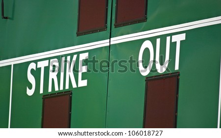 A cropped scoreboard in the outfield of a baseball field - stock photo