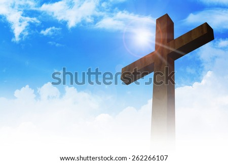 A cross on clouds background  - stock photo