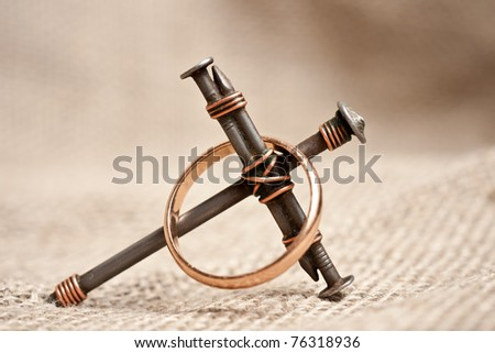 a cross with nails on canvas background - stock photo